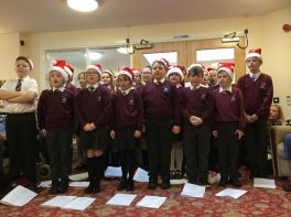 Carol singing at Rose Lodge